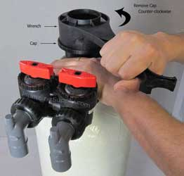 demonstration picture of acid neutralizer cap removal
