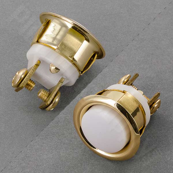 White and brass activation button