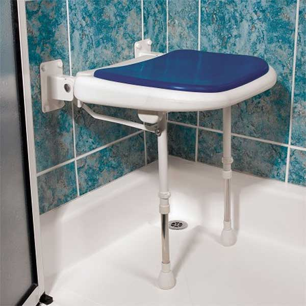 Wall mounted folding padded shower seat with gray accents