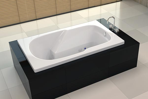 Americh Whisper pipeless whirlpool tub installed in bathroom. Americh Whirlpool Baths   luxury jetted bath tubs