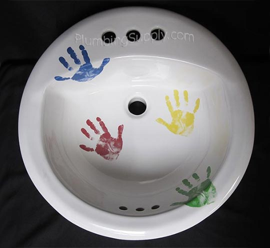 Hand decorated porcelain sink with colorful hand print design