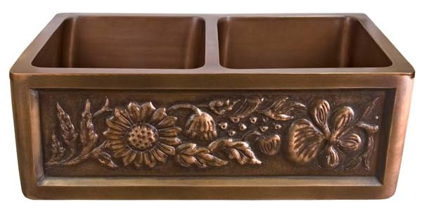 Click for larger example of this double bowl copper farmer sink with stylized flower motif