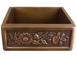 Single bowl copper farmer sink with sunflower motif front