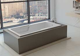 Americh whirlpool tub in classy freestanding deck in large open bathroom