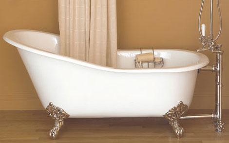 image of a slipper style cast iron clawfoot tub, shown in white