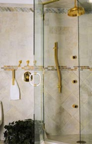 example of a polished brass grab bar installed in a shower