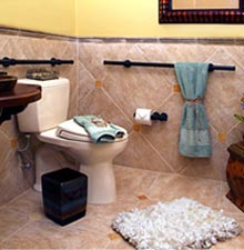 photo of sample installation of matte oil rubbed horizontal grab bars in bathroom