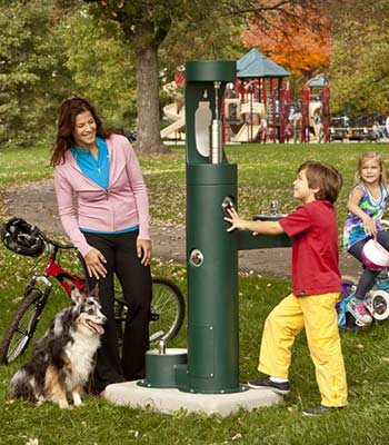 Family using outdoor bottle filler