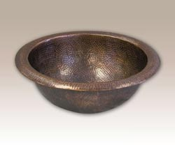 Classic round hammered copper sink