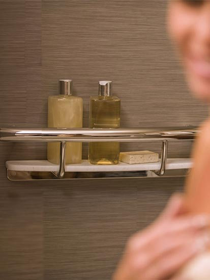 Grab bar with shampoo shelf being used