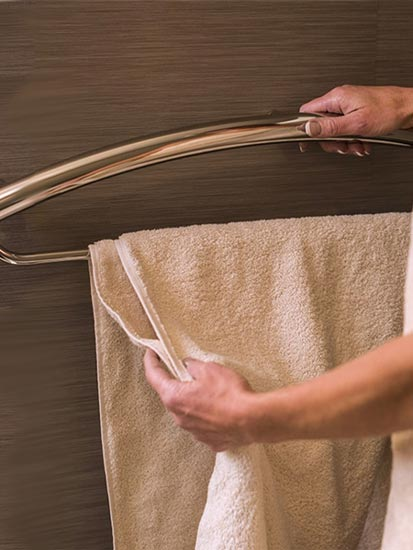 Combination grab bar/towel bar being used