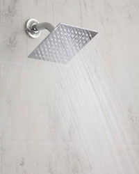 Example of an installed sqaure Rain Machine shower head, shown in chrome