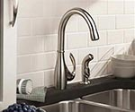 Single handle faucet with side spray