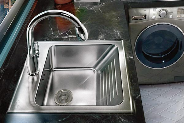 Drop-in stainless steel laundry sink with built-in washboard