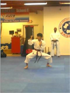 Jan completing his brown-black belt test in karate without nunchucks
