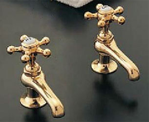 Sign of the Crab basin faucet with five spoke star handles in polished brass finish